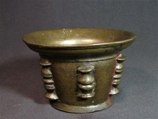 mortero bronce
