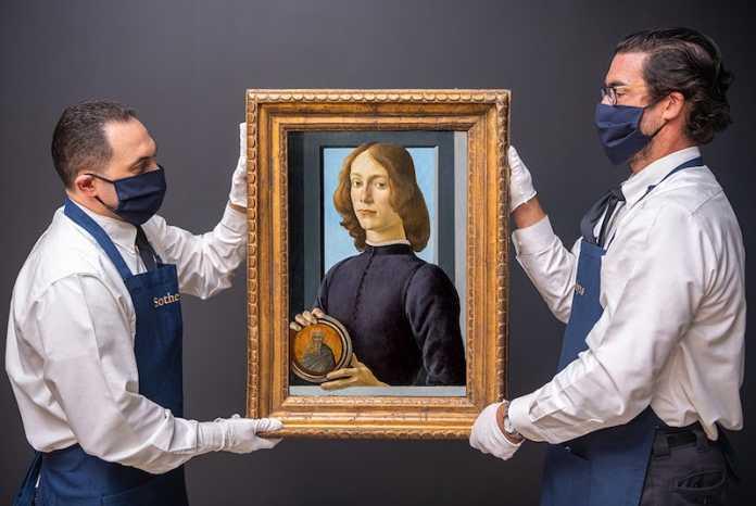 pintura botticelli Retrato de un joven sosteniendo un Roundel